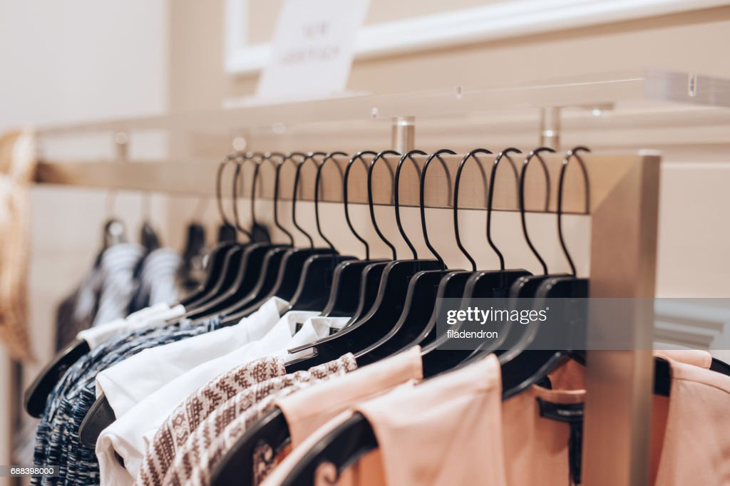 Dresses hanged in a clothing store : Stock Photo
