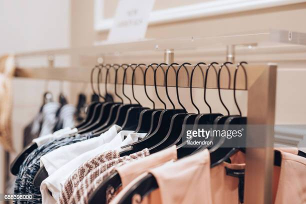 dresses hanged in a clothing store - evening gown stock photos and pictures