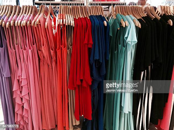 Dresses Hanging On Hanger In Shop