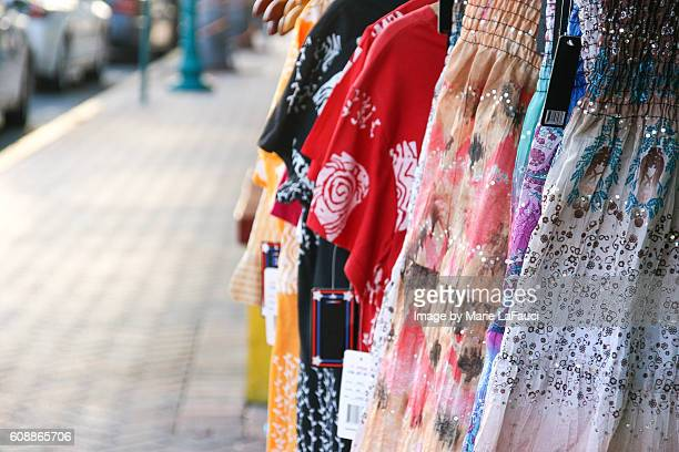 dresses on display on sidewalk - delray beach stock pictures, royalty-free photos & images
