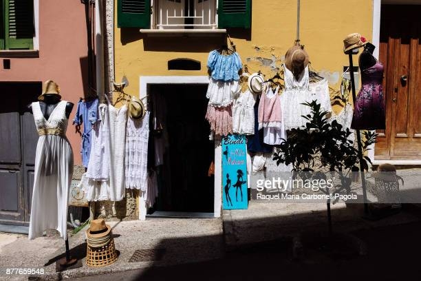 Dresses on display outside a local shop