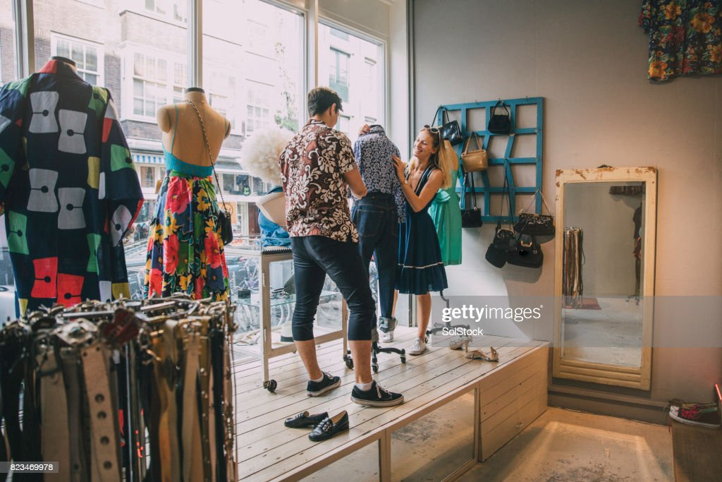 Dressing a Mannequin in a Shop Window : Stock Photo