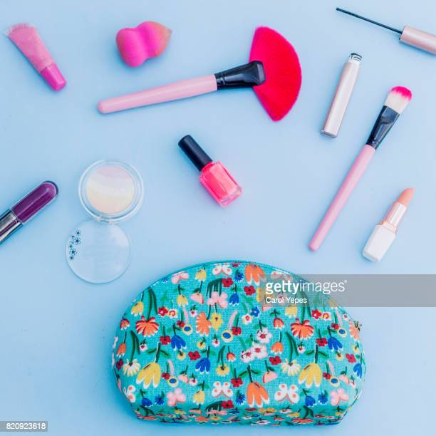 Dressing case with a lot of feminine objects.Blue background