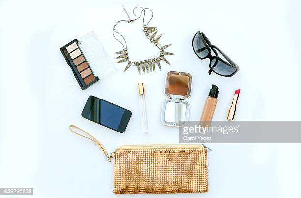dressing case with a lot of feminine objects.yellow background - accessoires stock-fotos und bilder