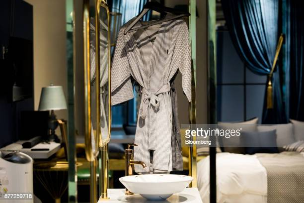 A dressing gown hangs in a mockup motel room at the Yanolja Co headquarters in Seoul South Korea on Tuesday Oct 10 2017 Yanolja Korean for 'hey let's...
