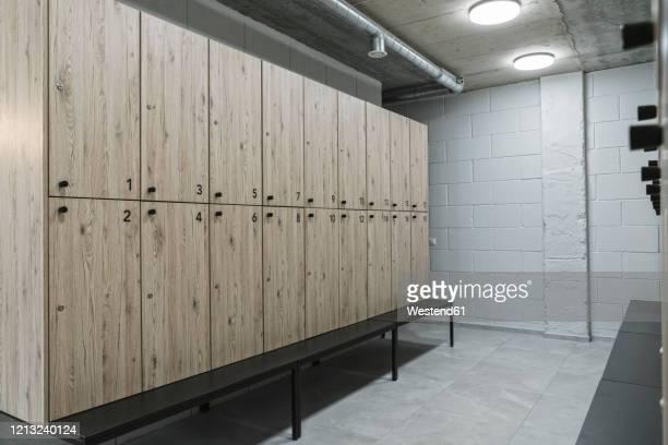 dressing room in a gym - umkleideraum stock-fotos und bilder