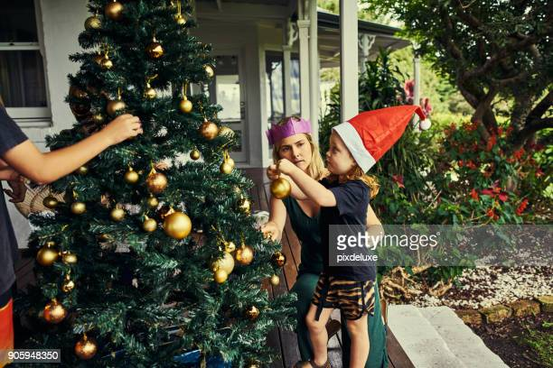 dressing the tree is our favorite part - christmas tree stock pictures, royalty-free photos & images
