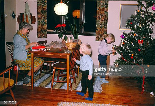dressing  tree for christmas - 1967 stock pictures, royalty-free photos & images
