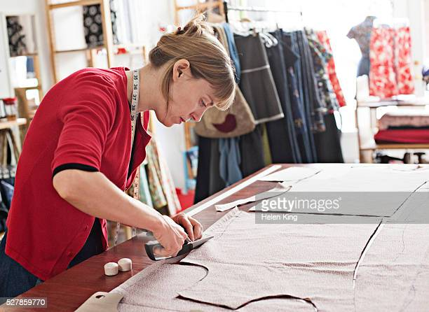 dressmaker at work - tailor stock pictures, royalty-free photos & images
