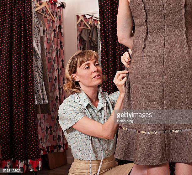 Dressmaker pins alterations for customer