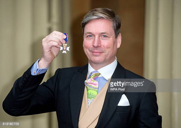 Dressmaker to the Queen Stewart Parvin with the Royal Victorian Order presented to him by Queen Elizabeth II following an Investiture ceremony at...