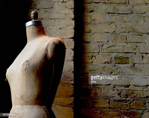 A dressmaker's model stands at the '14 oz Store' in the Cumberland house on Kurfuerstendamm in Berlin on April 16 2013 The fashion store was elected...