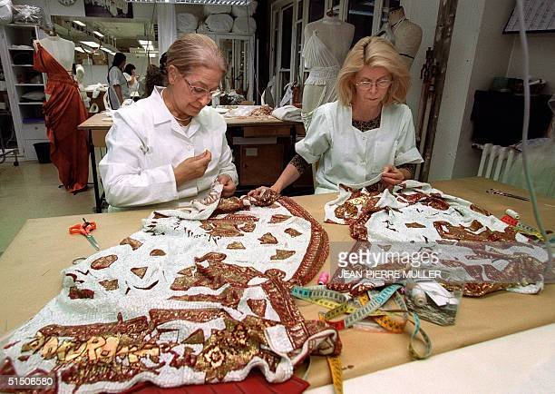 Dressmakers put a final touch to John Galliano's creations at Christian Dior studio for the SpringSummer Haute Couture 2001 collection 21 January...