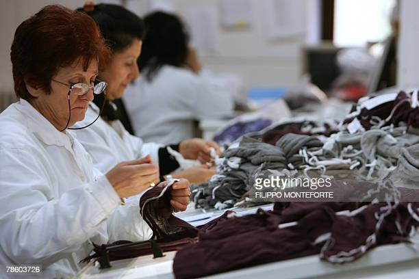 DOLMADJIAN Dressmakers sew cachemere pieces 14 December 2007 in Italian luxury designer Brunello Cucinelli factory in the medieval hilltop village of...