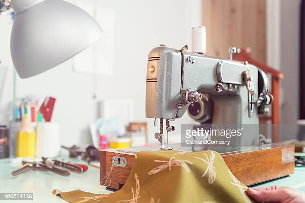dressmaker's workshop with retro sewing machine - sewing machine stock pictures, royalty-free photos & images