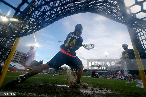 Drew Adams of Eclipse stops a shot against Supernova during the 2013 Major League Lacrosse All Star Game at American Legion Memorial Stadium on July...