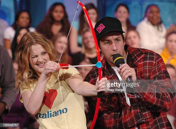 Drew Barrymore and Adam Sandler during Drew Barrymore and Adam Sandler Visit MTV's 'TRL' February 13 2004 at MTV Studios Times Square in New York...