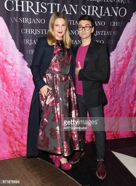 Drew Barrymore and Christian Siriano attend the release celebration of his book 'Dresses To Dream About' at the Rizzoli Flagship Store on November 8...