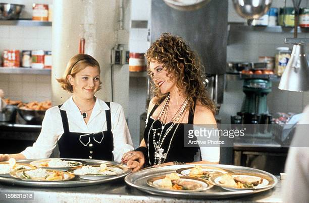 Drew Barrymore and Christine Taylor work as waitresses in a scene from the film 'The Wedding Singer' 1998