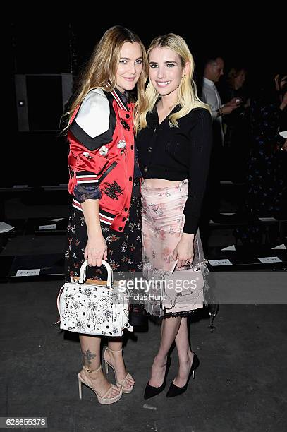 Drew Barrymore and Emma Roberts attend Coach 75th Anniversary Women's PreFall and Men's Fall Show on December 8 2016 in New York City