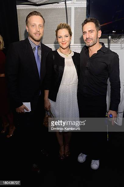 Drew Barrymore and InStyle Managing Editor Ariel Foxman pose with designer Marc Jacobs backstage at the Marc Jacobs Spring 2014 fashion show at The...