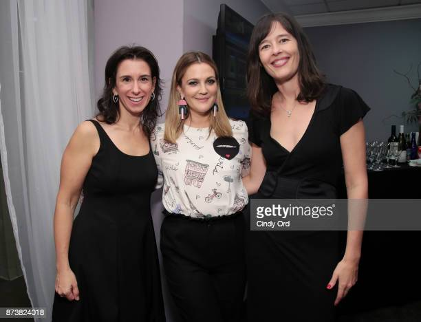 Drew Barrymore and New York Times journalists Jodi Kantor and Megan Twohey pose backstage at Glamour's 2017 Women of The Year Awards at Kings Theatre...