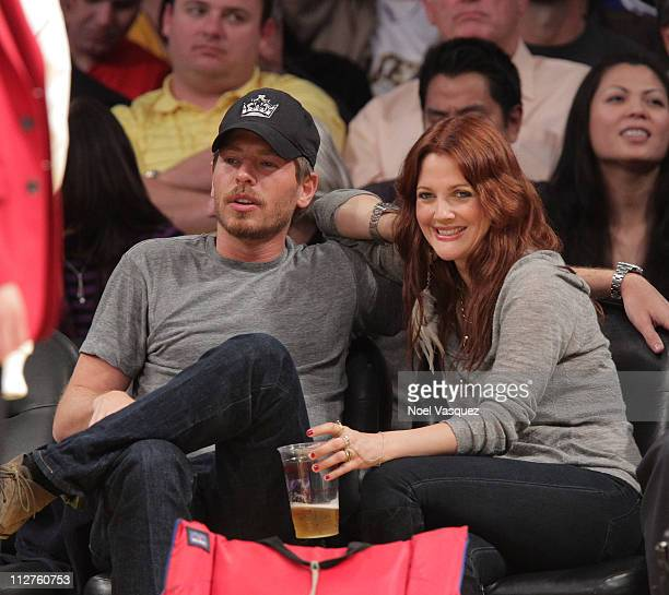 Drew Barrymore and Will Kopelman attend the game between the New Orleans Hornets and the Los Angeles Lakers at Staples Center on April 20 2011 in Los...