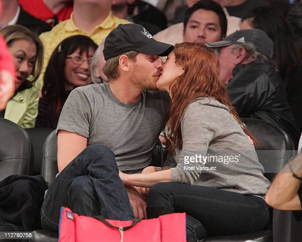 Drew Barrymore and Will Kopelman kiss at a game between the New Orleans Hornets and the Los Angeles Lakers at Staples Center on April 20 2011 in Los...