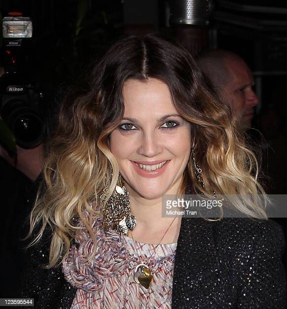 Drew Barrymore arrives at a preOscar dinner with Charles Finch hosted by Chanel held at Madeo Restaurant on February 26 2011 in Los Angeles California
