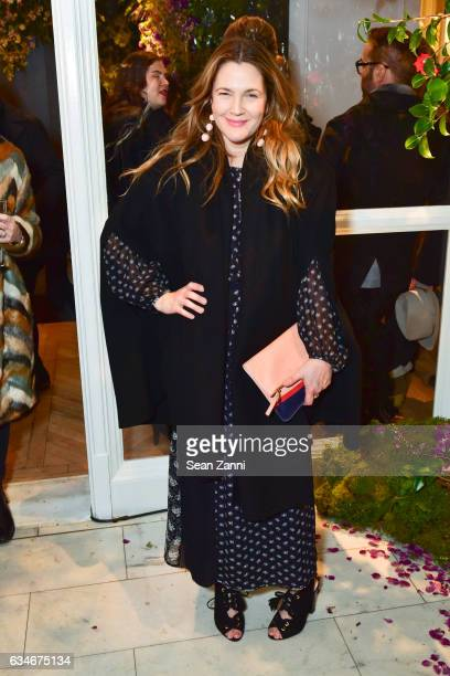 Drew Barrymore arrives at the Club Monaco show during New York Fashion Week at Club Monaco Fifth Avenue on February 10, 2017 in New York City.