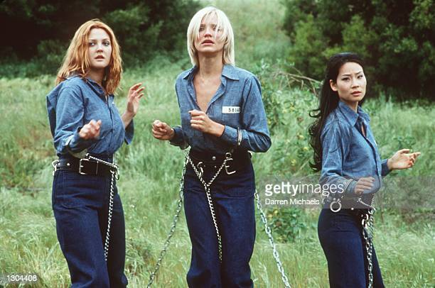 Drew Barrymore Cameron Diaz and Lucy Liu left to right star as a trio of elite private investigators in Columbia Pictures'' actioncomedy Charlie''s...