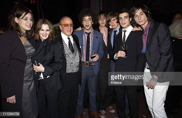 Drew Barrymore Clive Davis and The Strokes during 2003 Clive Davis PreGRAMMY Party Inside at The Regent Wall Street in New York City New York United...
