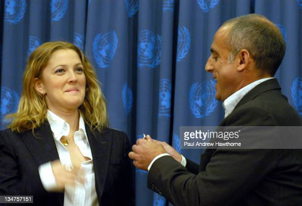 """Drew Barrymore has a pin placed on her lapel by Xorin Balbes Co-Chairman of Artists for the U.N. As she becomes the first artist to be named """"A..."""