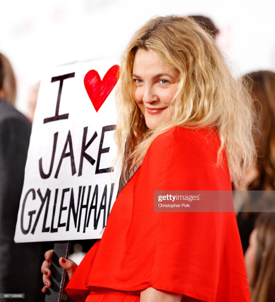 Drew Barrymore holds a sign that says 'I love Jake Gyllenhaal' as she walked the carpet at Netflix's 'Santa Clarita Diet' Season 2 Premiere at The Dome at Arclight Hollywood on March 22, 2018 in Hollywood, California.