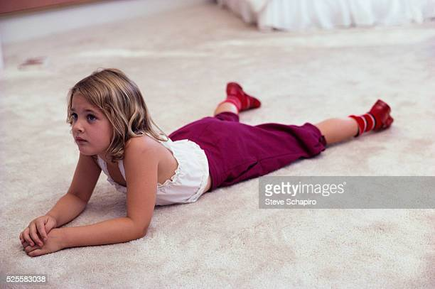 Drew Barrymore Lying on a Rug