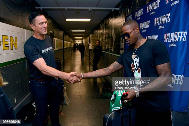 Drew Bledsoe and Terry Rozier of the Boston Celtics shake hands before the game against the Philadelphia 76ers in Game Five of the Eastern Conference...