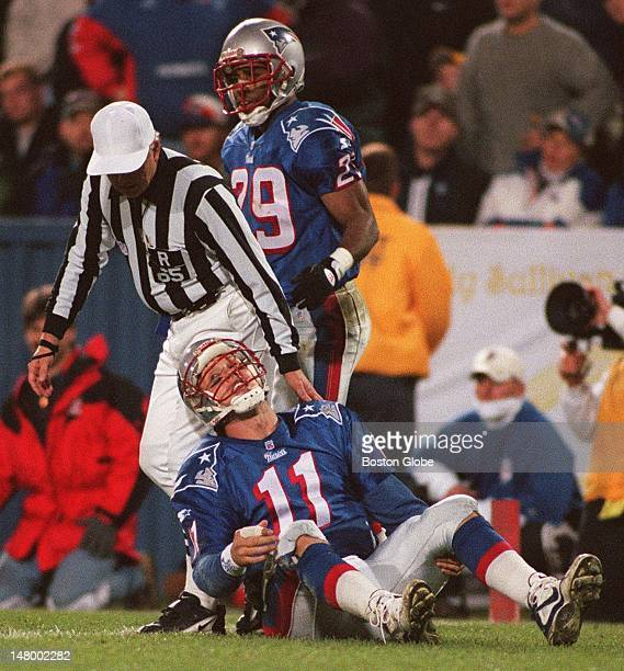 Drew Bledsoe gets up slowly during the second half of the Patriots 2521 victory agains the Buffalo Bills