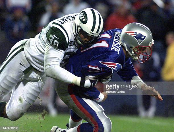 Drew Bledsoe is sacked by the Jets Anthony Pleasant late in the fourth quarter
