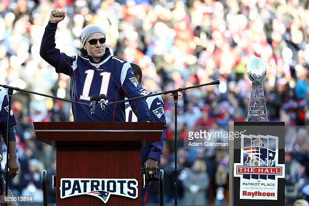 Drew Bledsoe of the New England Patriots' 2001 Super Bowl winning team is honored along with his teammates during halftime during the game between...