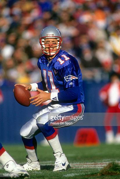 Drew Bledsoe of the New England Patriots drops back to pass against the San Diego Chargers November 20 1994 during an NFL football game at Foxboro...