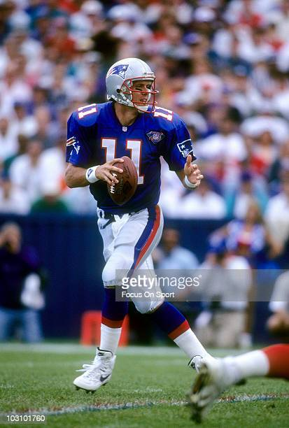 Drew Bledsoe of the New England Patriots drops back to pass circa 1994 during an NFL football game at Foxboro Stadium in Foxboro Massachusetts...