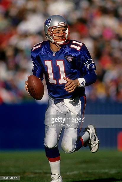 Drew Bledsoe of the New England Patriots looking for a receiver down field to pass to against the San Diego Chargers November 20 1994 during an NFL...