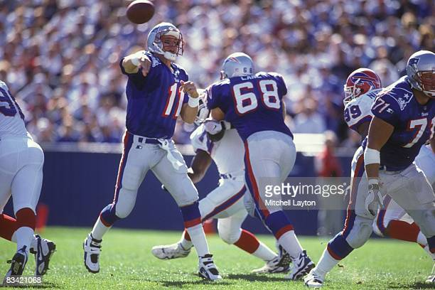 Drew Bledsoe of the New England Patriots throws a pass during a NFL football game against the Buffalo Bills on October 12 1997 at Gillette Stadium in...