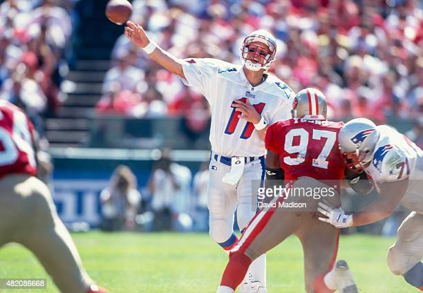 Drew Bledsoe of the New England Patriots throws a pass during an NFL game against the San Francisco 49ers played on September 17 1995 at Candlestick...