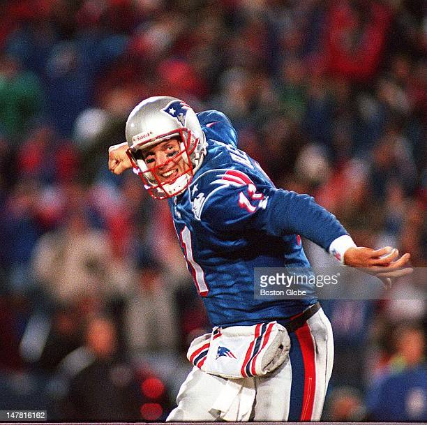 Drew Bledsoe of the Patriots celebrates after his third touchdown pass against the Miami Dolphins