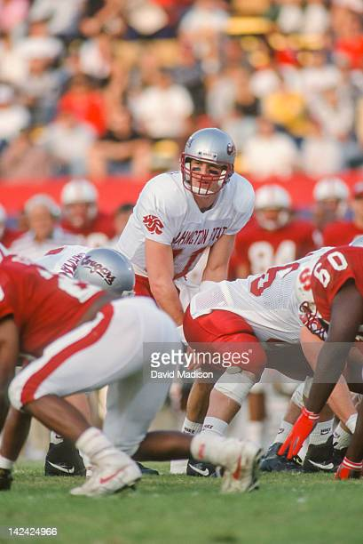 Drew Bledsoe of the Washington State Cougars calls signals during a PAC 10 football game against the Stanford Cardinal played on November 14 1992 at...