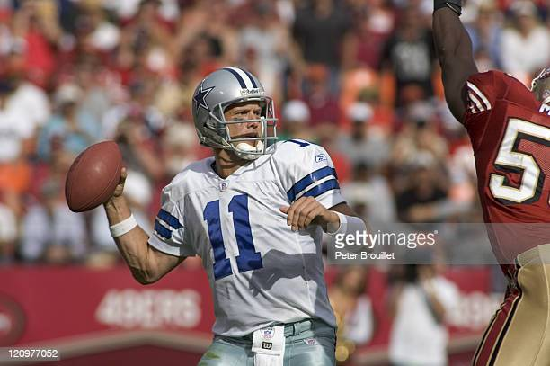 Drew Bledsoe quarterback for the Dallas Cowboys surveys the field as he drops back to pass in a game against the San Francisco 49ers at Monster Park...
