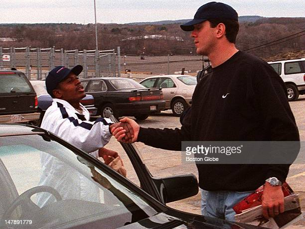 Drew Bledsoe shakes hands with an unidentified Patriots player