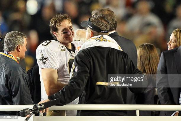 Drew Brees and head coach Sean Payton of the New Orleans Saints react after defeating the Indianapolis Colts during Super Bowl XLIV on February 7...