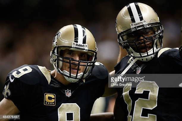 Drew Brees and Marques Colston of the New Orleans Saints celebrate after a touchdown against the Carolina Panthersat MercedesBenz Superdome on...